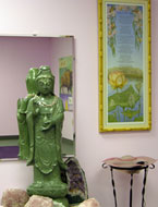 Our Kwan Yin statue was purchased in Reno, NV. She is solid serpentine and weights about 145 lbs. The Painting and poem to her left were inspired by Kwan Yin and came to us from artist Dawn Flores in Richmond, VA.